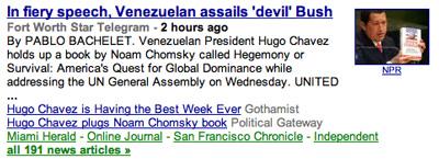 Chavez holding Chomsky aloft