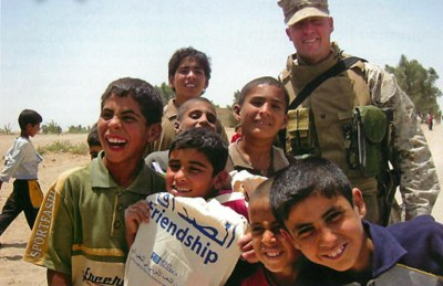 Marines passing out Spirit-of-America-provided school supplies in Ramadi, Iraq