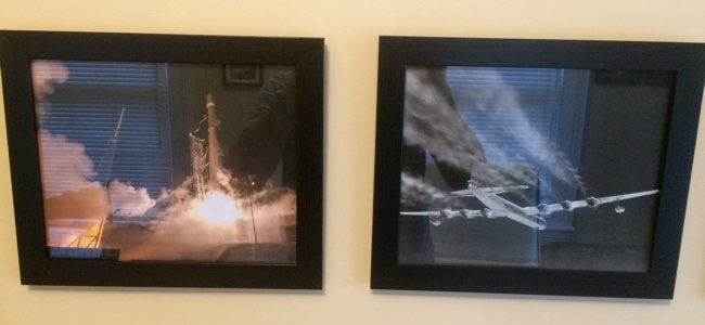 Framed photos of a Falcon 9 launch, and a Convair B-36 in flight