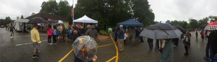 gathering in the rain for Memorial Day ceremony
